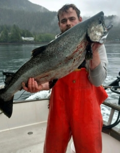 Man holding fish in alaska
